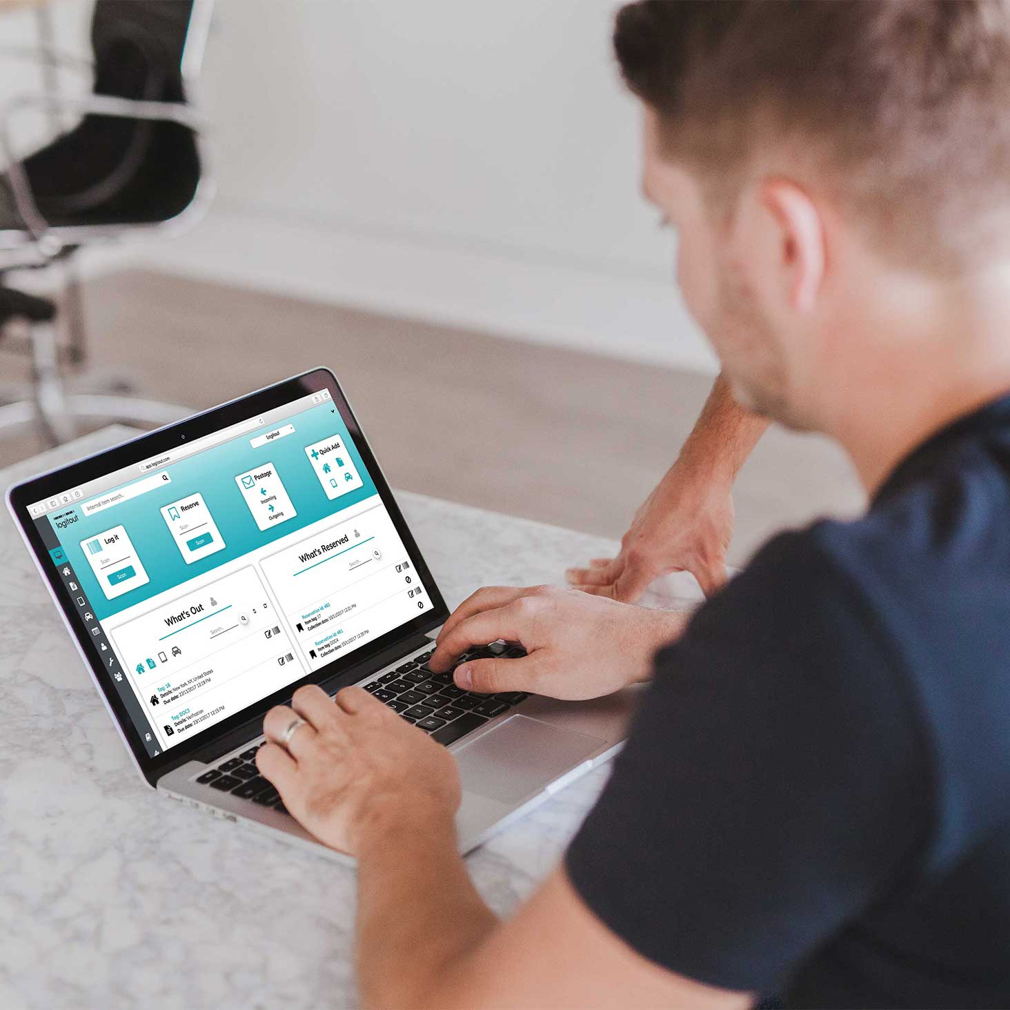 Man Using Logitout Dashboard on a Laptop